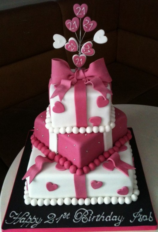 Pink and white hearts present cake