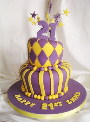Pink and yellow topsy turvey 21st birthday cake