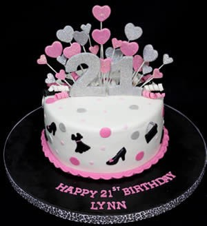 White 21st birthday cake with pink and silver hearts