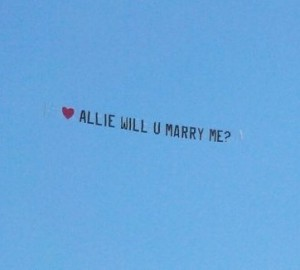 Fly a will you marry me sign from a plane
