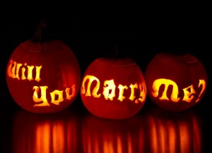 Propose at halloween by carving 'will you marry me' into pumpkins